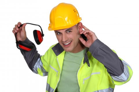 Worker_pulls_earmuffs_off_Fotosearch_k8133492